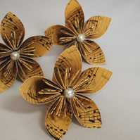 20 Origami kusudama flowers in a vintage music design