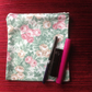 Pink and green floral purse