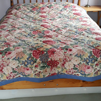 Quilt in Sanderson rose and peony fabric, hand quilted