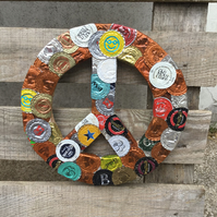 Upcycled bottletops PEACE symbol