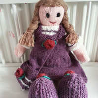Adorable handknitted doll