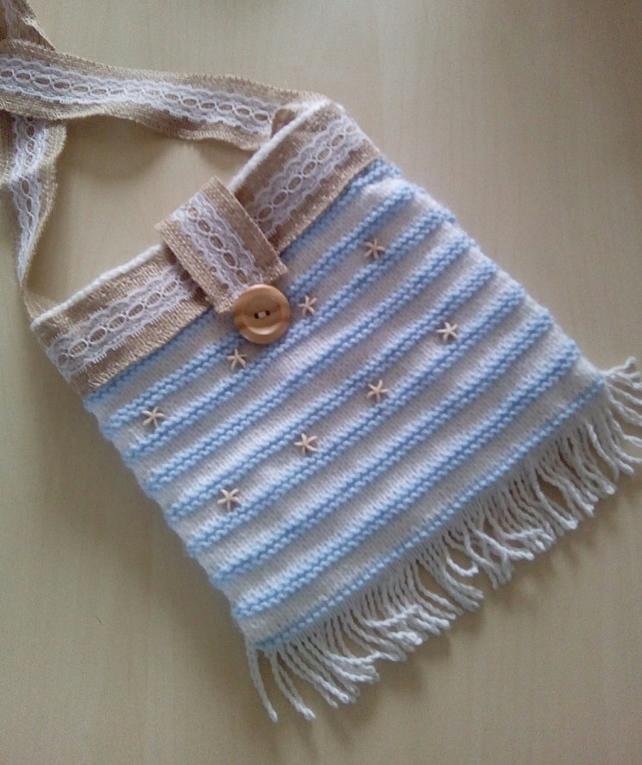 hand knitted shoulder bag.