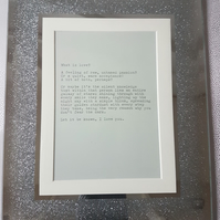 Framed poem 'What is love?'