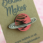Red Saturn Planet Pin Badge