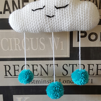 Cloud decoration with blue pom poms