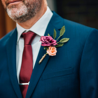 Paper Rose Buttonhole- Burgundy and Peach with Green Leaves