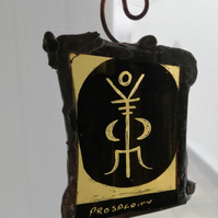 Stained Glass Prosperity Sigil with amber coloured glass.