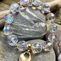 Crystal, gold and heart charm bracelet.