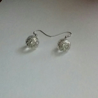 Clear Crystal Pierced Earrings with Figree Silver Detail.  Short drops.