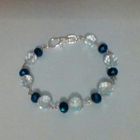 Bracelet. Metallic Blue and Sparkly  Clear Crystals.