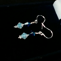 Swarovski Opal and Capri Bicone Crystal Pierced Earrings.  Sterling Silver.
