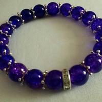 Purple Bracelet with Silver Star Spacers and  Sparkly Front Detail.