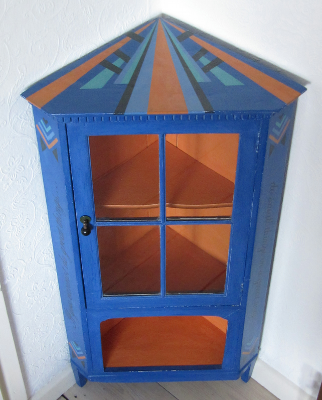 Small display cabinet with Art Deco inspired design In Annie Sloan palette.