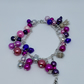 Child's pink and purple beaded bracelet