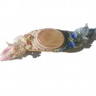 Rose Quartz Hair Clip with pink and blue leaves, embellished with flowers