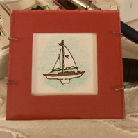 Miniature sailboat framed painting