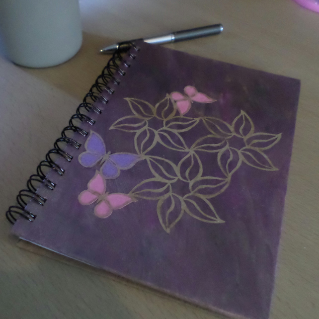 A5 hardback lined notebook with purple and pink floral decoration
