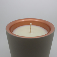 Soy wax scented candle in a beautiful concrete candle holder