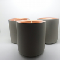 Set of three scented candles in grey and copper concrete containers