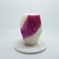Pink coloured geometric shaped pillar candle and candle plate