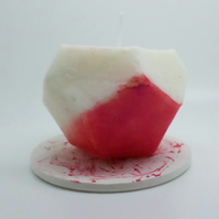 Geometric shaped red painted pillar candle and candle plate