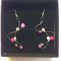 Purple and pink wave style earrings