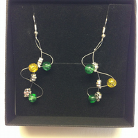 Green and yellow wave style earrings