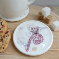Bone china bird on fern coaster
