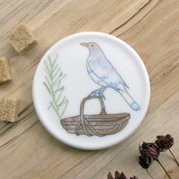 Bone china blackbird on trug coaster