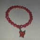 Red Stretchy Bracelet With Scarlet Shirt Charm