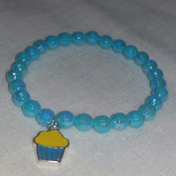 Turquoise Stretchy Bracelet With Cupcake Charm