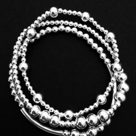Set of three sterling silver beaded stacking bracelets