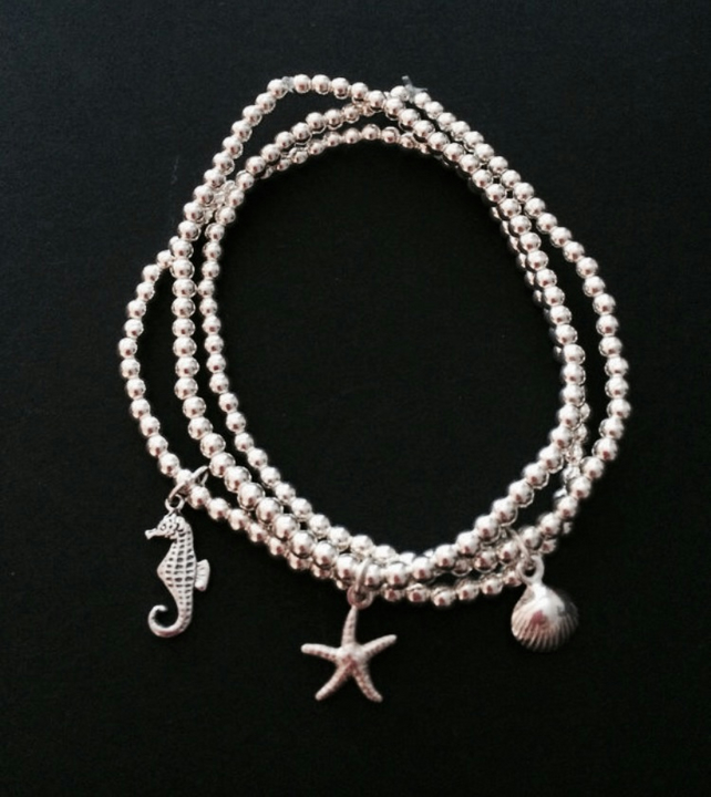Set of 3 sterling silver beaded stretch bracelets with shell, seahorse charms
