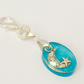 Keyring Moon and star suspended in Aqua Resin Gift Wrapped UK