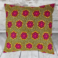 Cushion cover. African wax print in pink and indigo on khaki