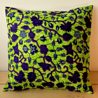 Cushion cover. African wax print in purple and indigo on lime green