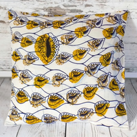 Cushion cover. African wax print, cowrie shells blue and yellow on cream