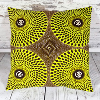 Cushion cover. African wax print, lime green and brown circles on khaki