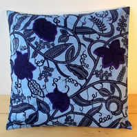 Cushion cover. African wax print, indigo and purple on light blue