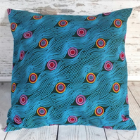 Cushion cover. African wax print, multicolour circles on teal and turquoise