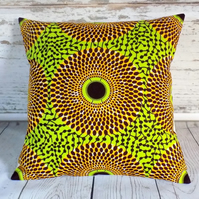 Cushion cover. African wax print, orange and brown circles on lime green