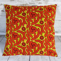 Cushion cover. African wax print, red on lime green and khaki