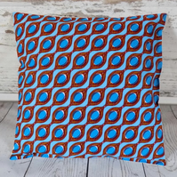 Cushion cover. African wax print, blue circles in brown ovals