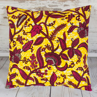 Cushion cover. African wax print, magenta and burgundy on yellow