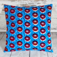 Cushion cover. African wax print, multicolour circles on bright blue