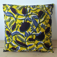 Cushion cover. African wax print, indigo and burgundy on yellow and white