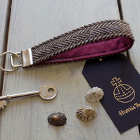 Harris Tweed key fob wrist strap in brown herringbone with crimson lining
