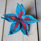 Felted flower brooch: merino wool and silk in bright teal and red