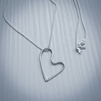 Hand-forged sterling silver open heart necklace