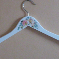 Decorated adult wooden clothes hanger